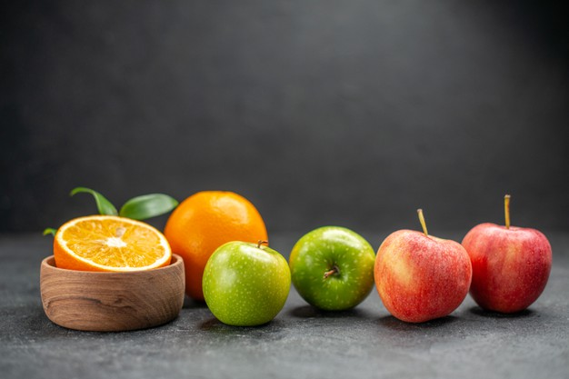 close-up-view-benefit-fruit-salad-with-fresh-oranges-green-apple-dark-table_140725-86567-6713099-9080257