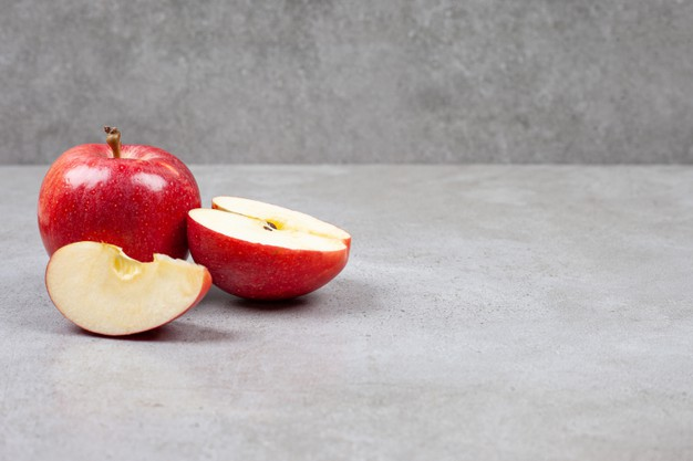 fresh-organic-apples-whole-sliced-red-apples-grey-table_114579-39298-1234323-7324803