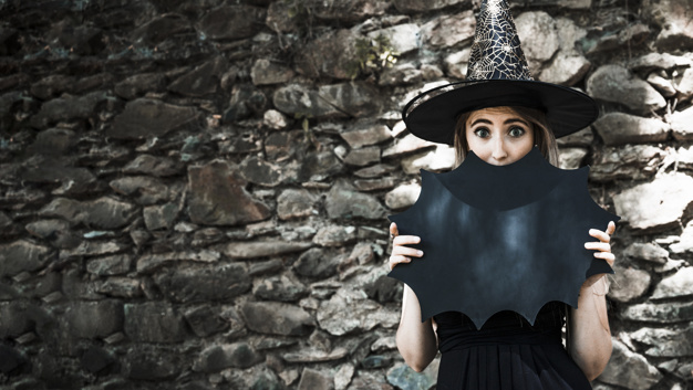 young-woman-witch-hat-closing-mouth-with-halloween-decoration_23-2147902830-9007125-1969589